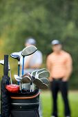 stock photo of golf bag  - Golf clubs in bag at golf course - JPG
