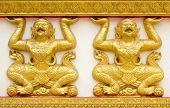 stock photo of hanuman  - Hanuman wall art at public temple in Thailand - JPG