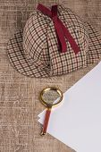 foto of private investigator  - Wrapped paper sheets and magnifying glass on Old Wooden table - JPG