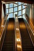 stock photo of escalator  - An escalator going up indoor gold tones - JPG