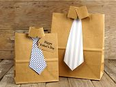 picture of seasons greetings  - Fathers Day handmade shirt and tie gift bags with greeting card on a wood background - JPG