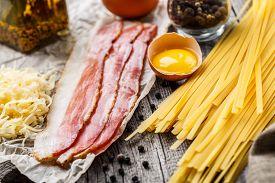 stock photo of carbonara  - Ingredients for pasta carbonara on a rustic background - JPG