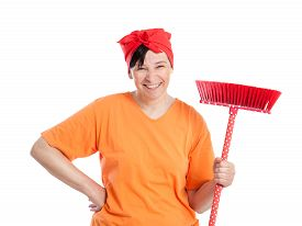 foto of ordinary woman  - Middle aged woman smiling with dotted broom isolated on white - JPG