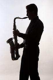 picture of saxophone player  - Saxophone amorous player silhouette on grey background - JPG