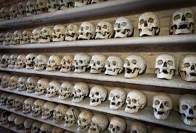 pic of eye-sockets  - view of human skulls inside a Christian catacomb - JPG