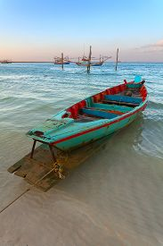 picture of sloop  - lonely rowing boat at sunset - JPG