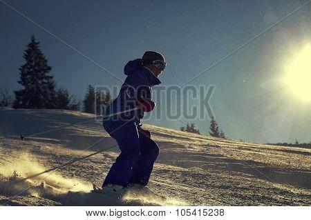 Girl Skier Slade Down On