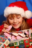 Photo of girl and christmas gingerbreads.
