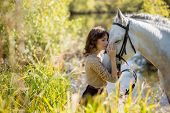 Постер, плакат: Beautiful girl with the white horse