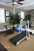 stock photo of exercise bike  - an exercise room inside a residential home - JPG