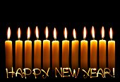 pic of fire ant  - Twelve alight candles ant text Happy New Year over black background - JPG