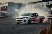 Pick-up Car Perform Drifting With Smoke poster