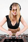 Female Dj Adjusting Sound Levels
