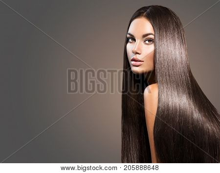 poster of Beautiful long Hair. Beauty woman with luxurious straight brown hair on dark background. Beautiful b
