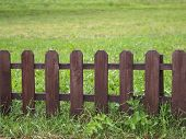 Wooden Fence On Green Grass