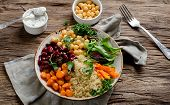 Vegetarian Buddha Bowl With Quinoa And Chickpea poster