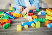 Little Boy Playing With Colorful Plastic Construction Blocks poster