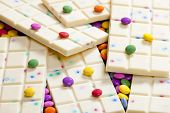 still life of white chocolate with smarties