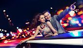 picture of limousine  - Elegant couple traveling a limousine at night - JPG