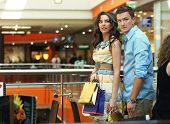 Beautiful couple on shopping trip