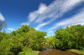 image of winnebago  - Fair weather clouds on a spring day over the Kishwaukee River of Illinois - JPG