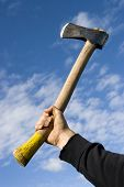 pic of infraction law  - hand with an axe on sky background - JPG