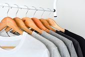 Close Up Collection Of Black, Gray And White Color (monochrome) Hanging On Wooden Clothes Hanger In  poster