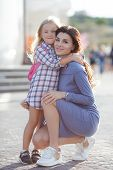 Mother And Daughter Outdoors In City. Playing And Having Fun. Fashion Happy Mother And Child Daughte poster