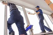 Master Workers Install Window Sill Repair In The House Building Asians poster