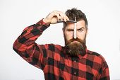 Handsome Bearded Hairdresser In Stylish Wear Is Holding A Straight Razor While Standing At The Barbe poster