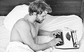 Morning Inspiration. Writer Use Manual Typewriter Daily Work. Man Writer Lay Bed Working On New Book poster