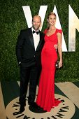 LOS ANGELES - FEB 26:  Jason Statham; Rosie Huntington-Whiteley arrive at the 2012 Vanity Fair Oscar Party  at the Sunset Tower on February 26, 2012 in West Hollywood, CA