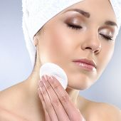Young attractive woman in towel making the spa treatment
