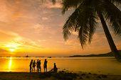 People enjoying the sunset at Nirvana Beach, Padang, Sumatera Island, Indonesia
