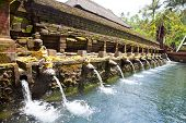Holy spring water in temple pura Tirtha Empul inTampak, one of  Bali's most important temples, Indon