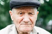 Very Old Caucasian Man Portrait. Grandfather In Hat. Portrait: Aged, Elderly, Loneliness, Senior Wit poster