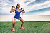 Exercise woman with fitness elastic band workout in outdoor gym . Asian girl doing resistance traini poster