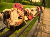 Multi-colored Padlocks With Missing Keys On The Bridge Are Symbols Of Fidelity And Love. . The Names poster