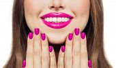 Nails And Lips. Woman Touching Her Cheeks Her Hands With Manicure Nails. Pink Color Lipstick And Nai poster