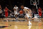 Penn State guard Tim Fraizerr dribbles the ball up the court