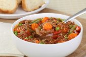 stock photo of ground-beef  - Bowl of vegetable beef soup with spoonful of soup - JPG