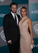 LOS ANGELES - JAN 15:  Natalie Zea & Travis Schuldt  arriving to Golden Globes 2012 After Party: WB / In Style  on January 15, 2012 in Beverly Hills, CA