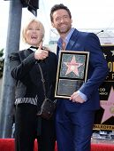 LOS ANGELES - DEC 12:  Hugh Jackman & Deborra-Lee Furness arriving to Walk of Fame Honors Hugh Jackm