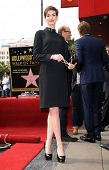 LOS ANGELES - DEC 12:  Anne Hathaway arriving to Walk of Fame Honors Hugh Jackman  on December 12, 2