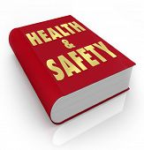 A red book with the words Health and Safety giving rules, regulations, guidance, instructions, direc