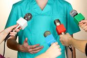 foto of politician  - Conference meeting microphones and doctor - JPG