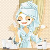 Cute girl with a cosmetic mask on her face in the bathroom