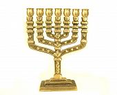 stock photo of tora  - golden colour jewish chandelier menorah on white background - JPG
