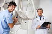 Technician And Radiologist At Clinic