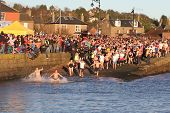 DUNDEE, UK - JANUARY 1: Swimmers taking part in the New Years Day Dook in Broughty Ferry Harbour Dun